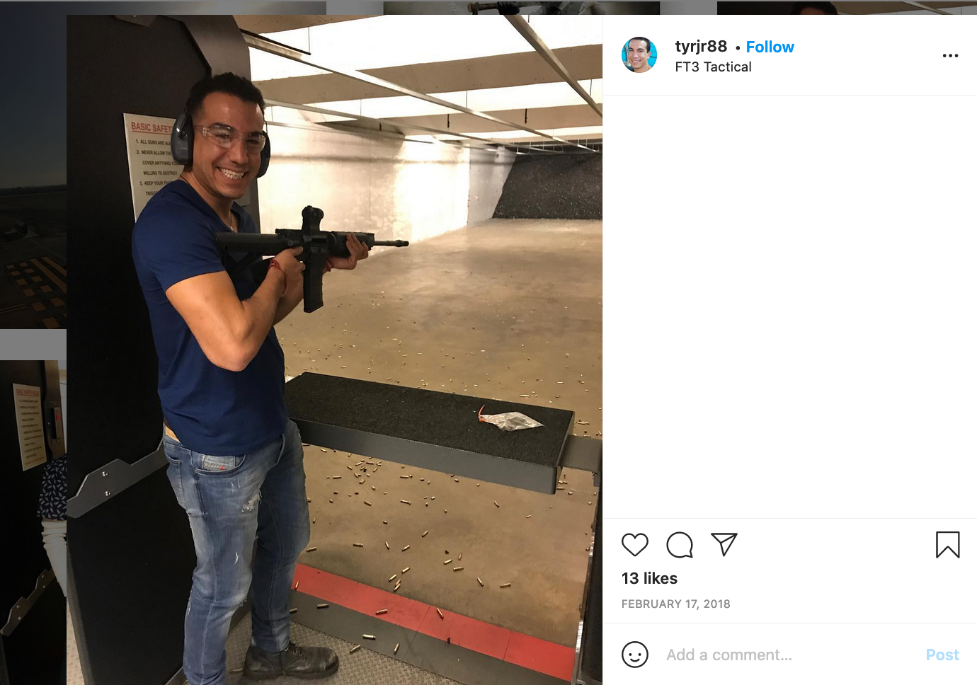 Roman smiling and posing with a rifle at a shooting range.