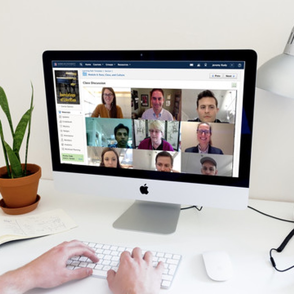 A group of people in a video conference