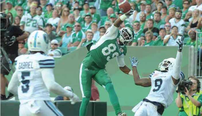 Duran Carter catching a football