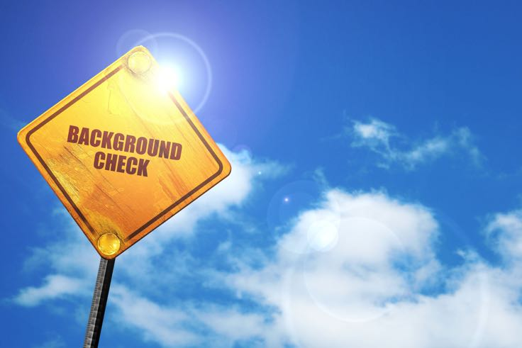 Background check street sign, cloudy blue sky