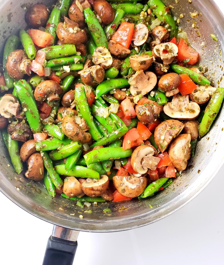 Pan with firecracker snap peas, mushrooms, tomatoes, and onion