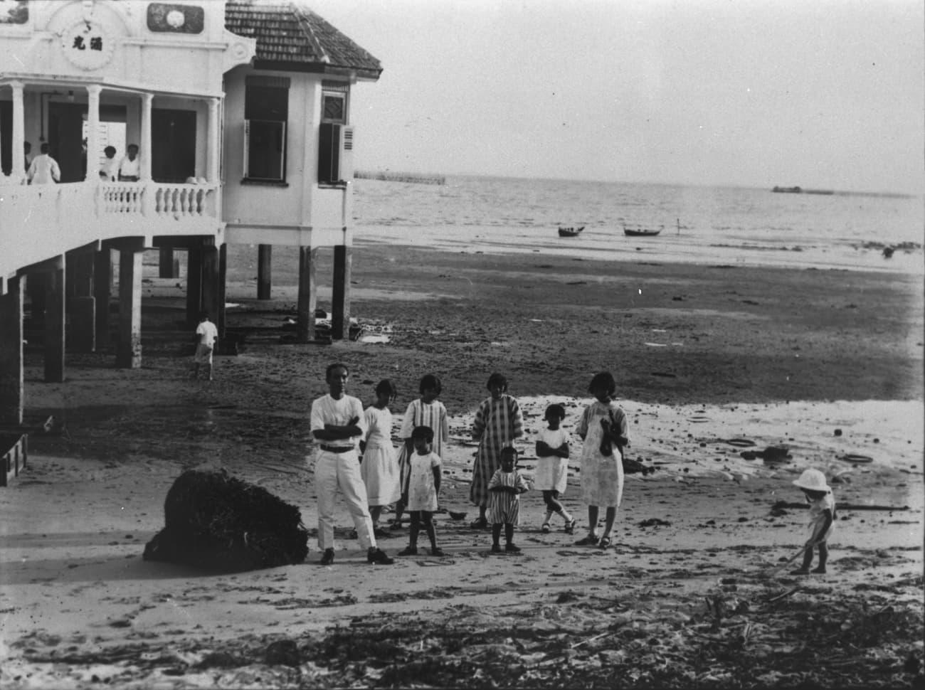A family at a beach house, 1920s