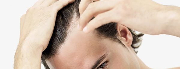 man running gel through his hair