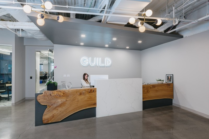 Guild employee sitting at the front desk of their office