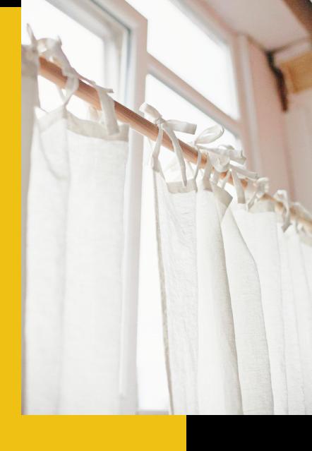 Retouche des ourlets sur vos rideaux