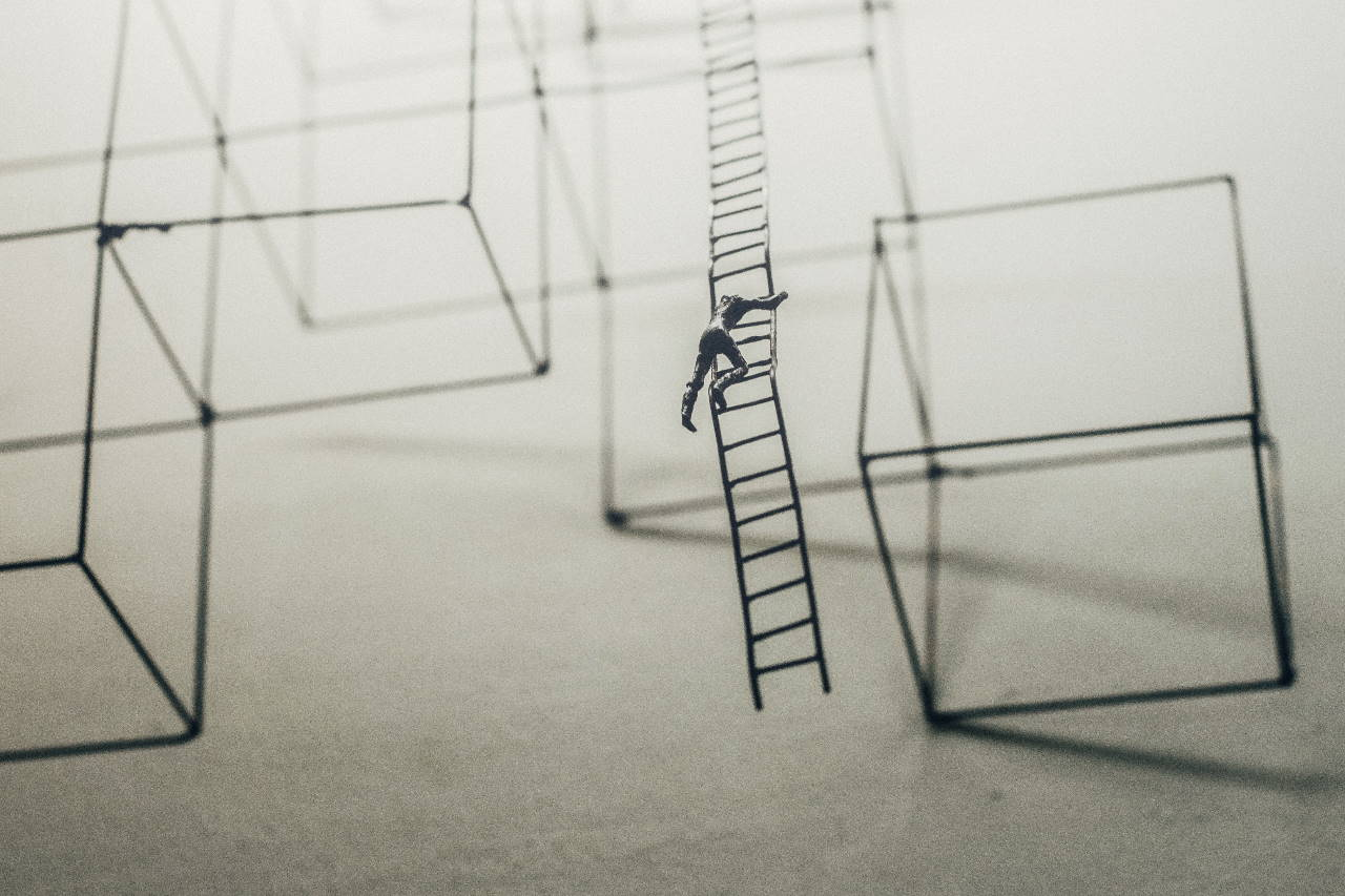 Model of a man climbing a ladder amongst wire cubes