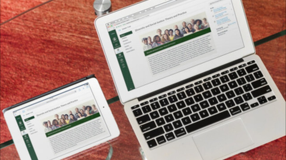 A tablet and a laptop with Tulane University's website opened