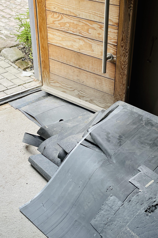 Exposed concrete slab and flooring underlay.