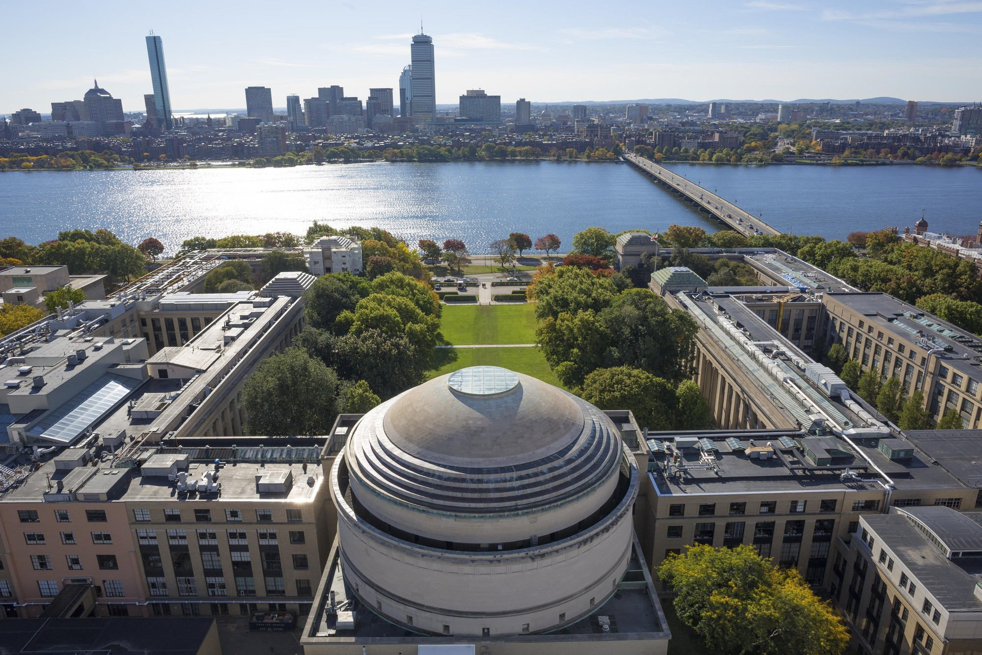 Bird's eye view of MIT University's Great Dome with the Charles River and Harvard Bridge in the background