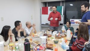The image shows when we brought hand-made dishes at our monthly activity
