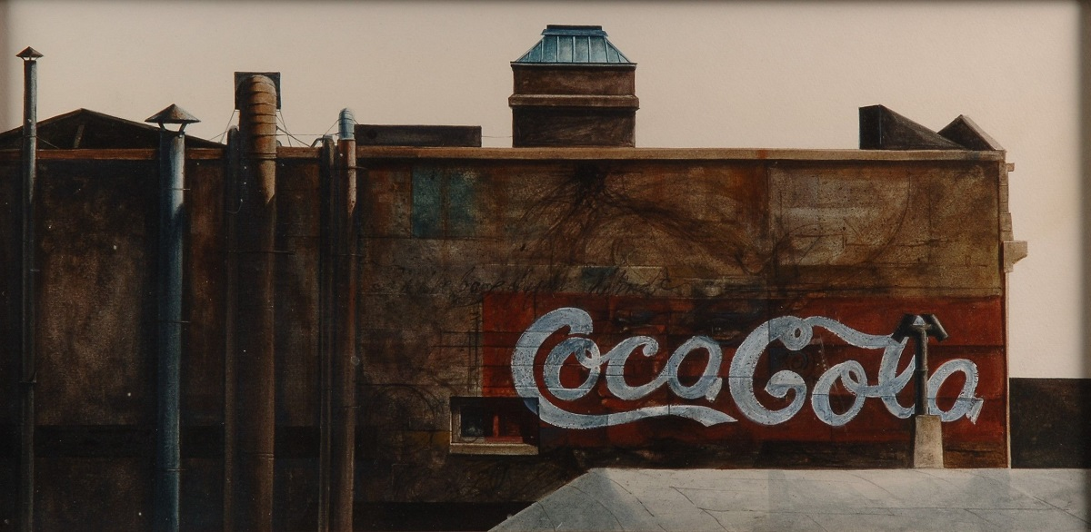coca cola sign on the side of an old building