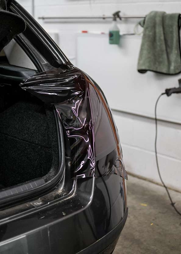 Fiat Stilo car right side rear light being tinted using LUXE Light film