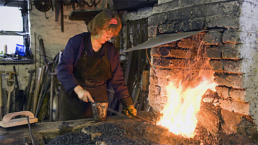 Woman Forging Metal