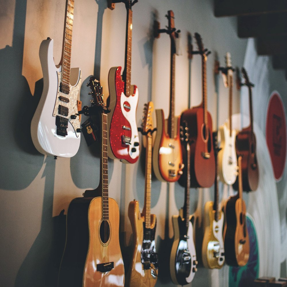 New guitars hung on wall