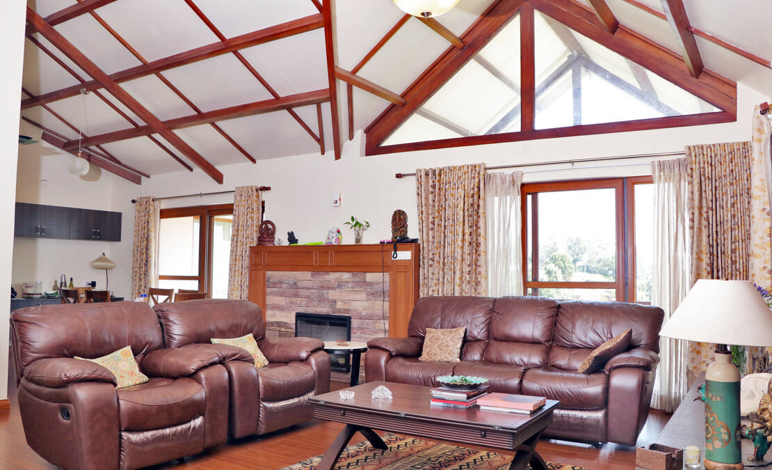 Living room of the house with a dormer window and a faux fireplace
