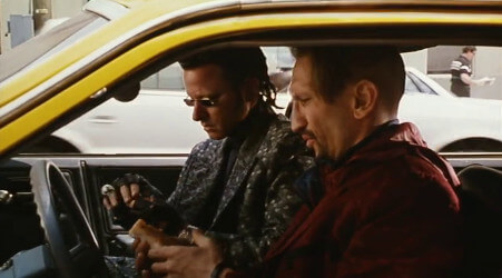 A shot from the Super Mario Bros. movie, showing Iggy and Spike sitting in a taxi cab, about to eat hot-dogs