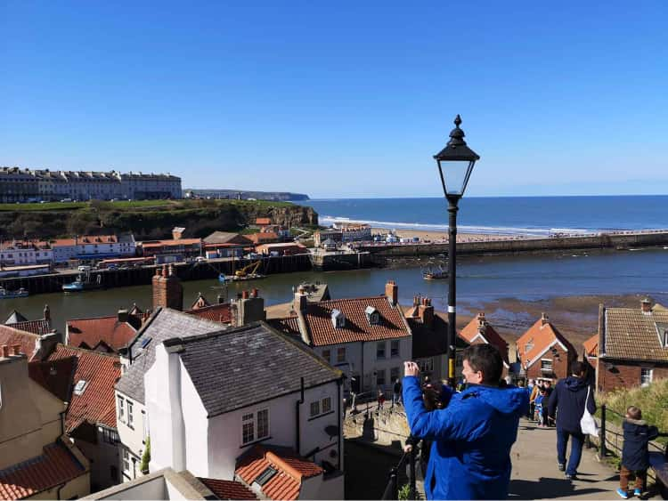 Whitby and it's pier, taken from midway up the famous 199 steps to the Whitby abbey.