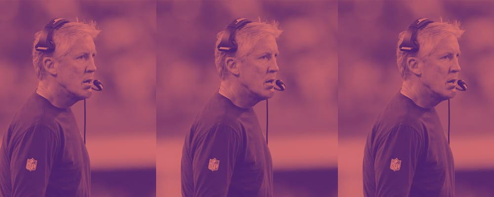 Pete Carroll with headset on