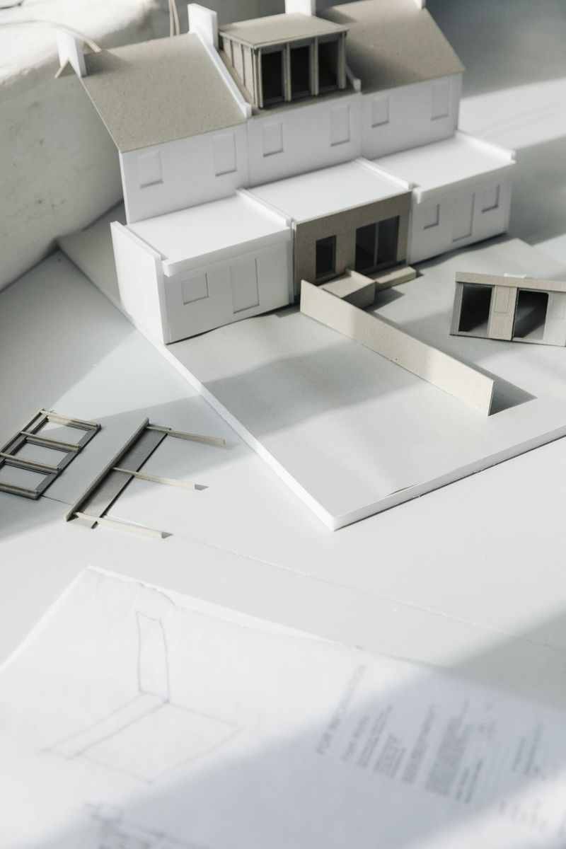Architectural card model on a sunny table top in From Works studio.