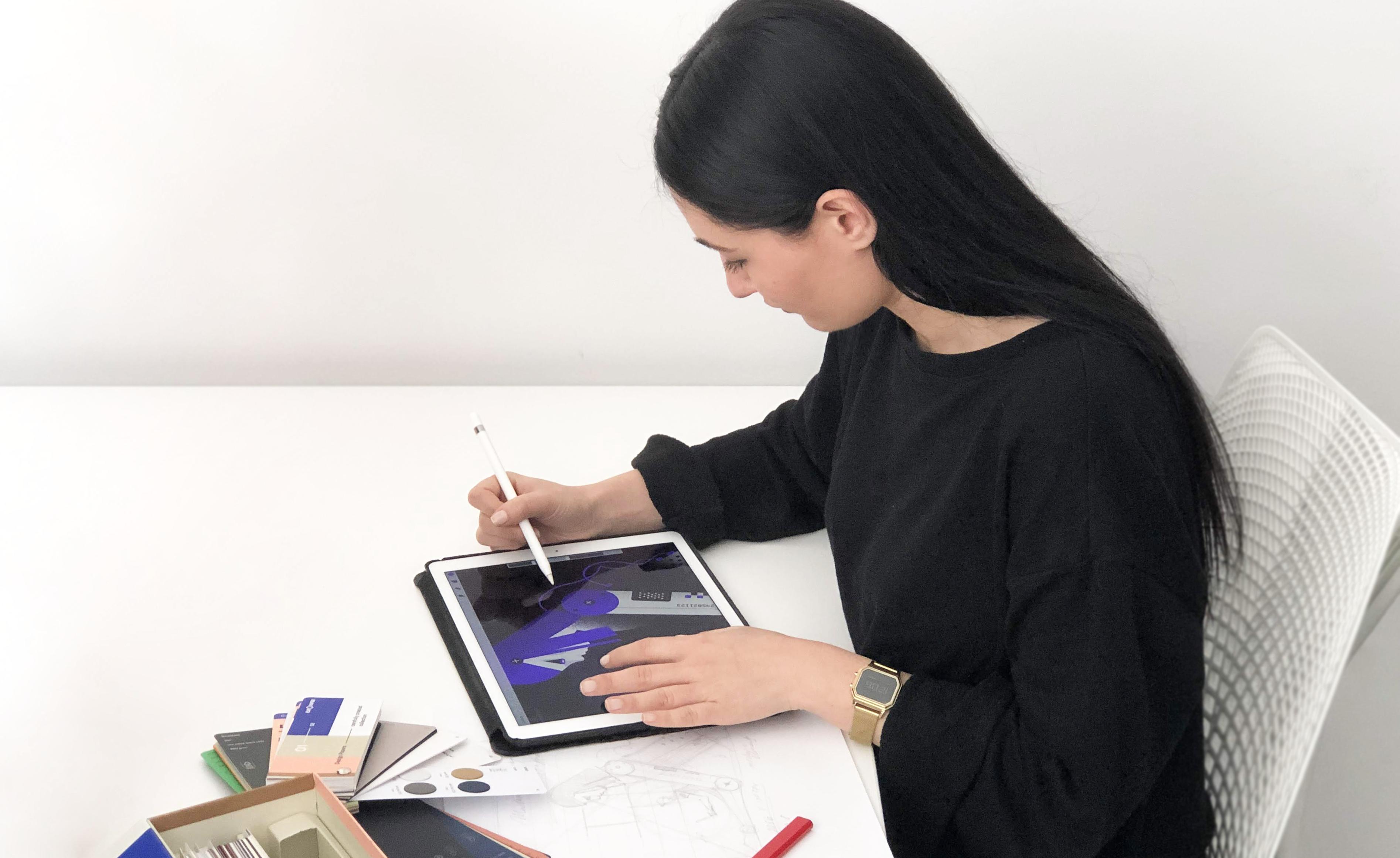 Dragana illustrating on her iPad.