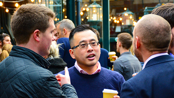 IAG Loyalty colleagues chatting at an event.