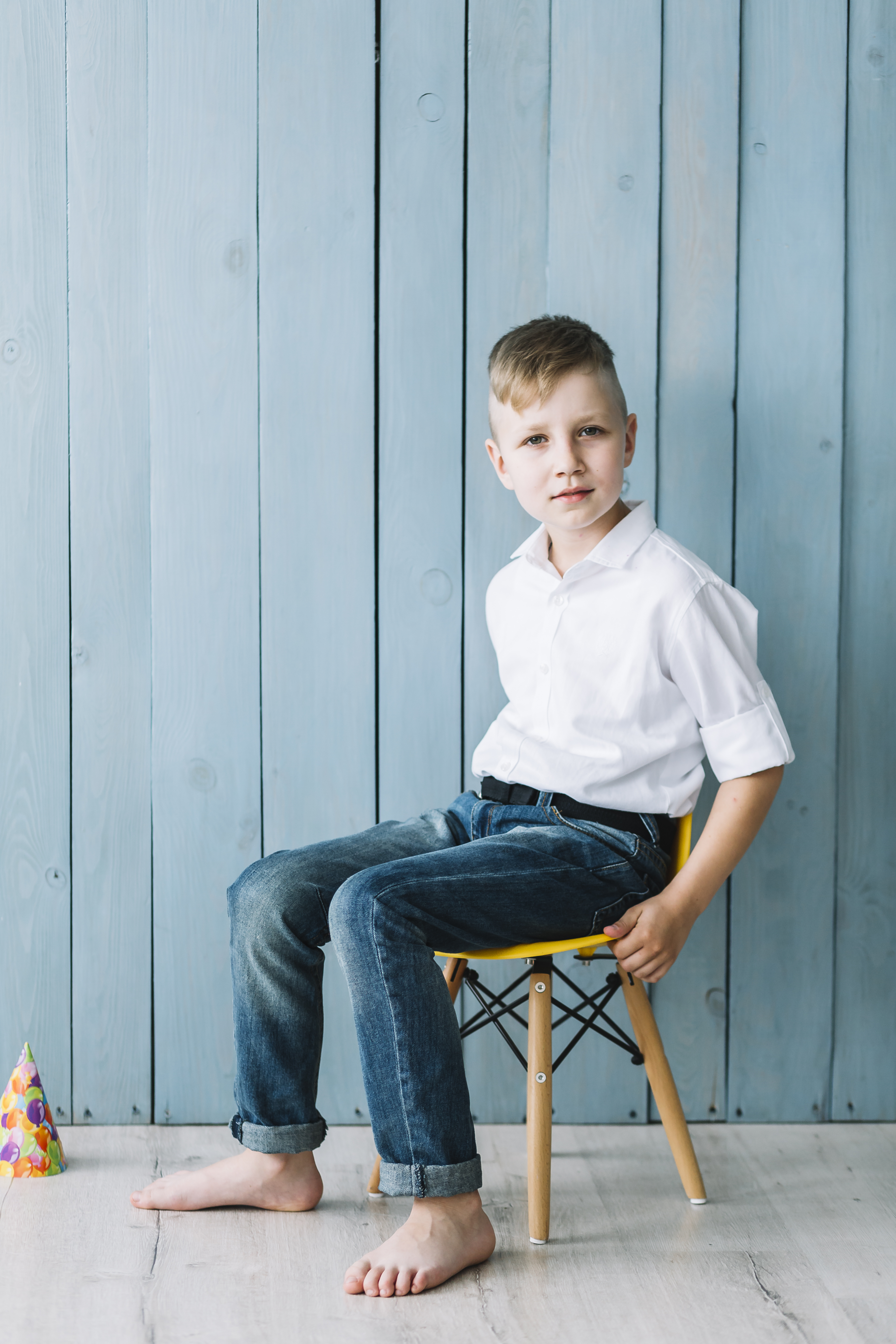 Boy sitting at his birthday party.