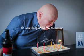 Birthday Boy Blowing Out the Candles on his Cake