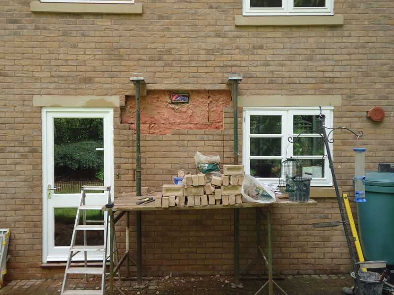 New uPVC window being installed to a property in Worcester
