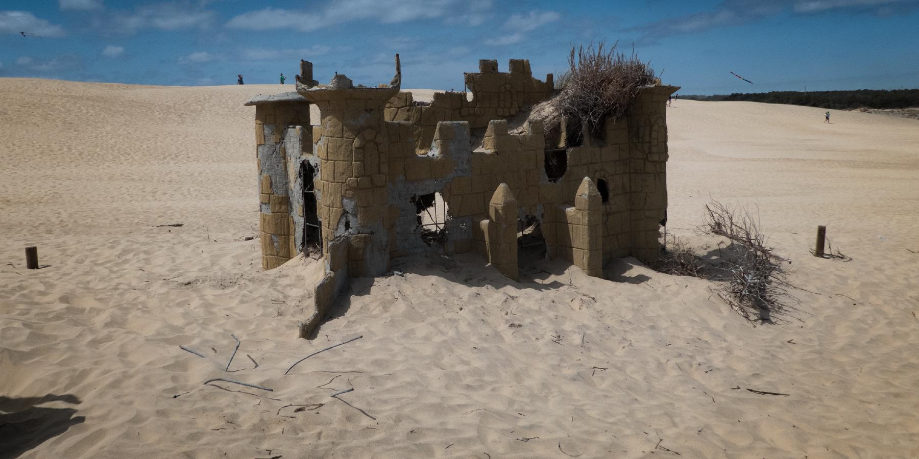 The ruins of a miniature golf castle peak out of the dunes of Jockeys Ridge in Nags Head, North Carolina.