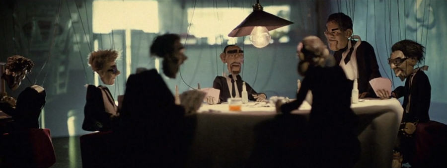 Clean the house campaign still of puppets around a table
