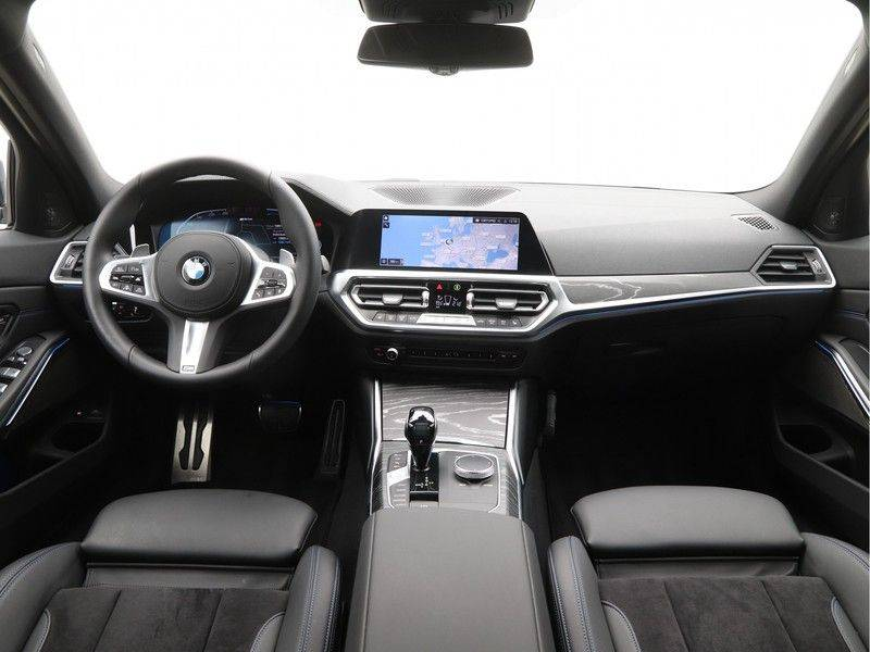 BMW 3 Serie Touring 330e xDrive High Executive M-Sport Automaat afbeelding 13