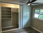 master bedroom remodel with glass closet doors