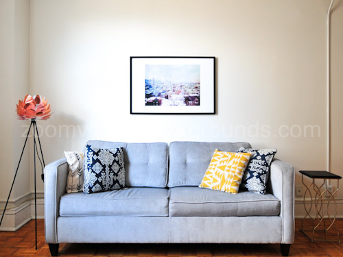 Stylish Home Study Virtual Background for Zoom with blue sofa, lamp and wall art