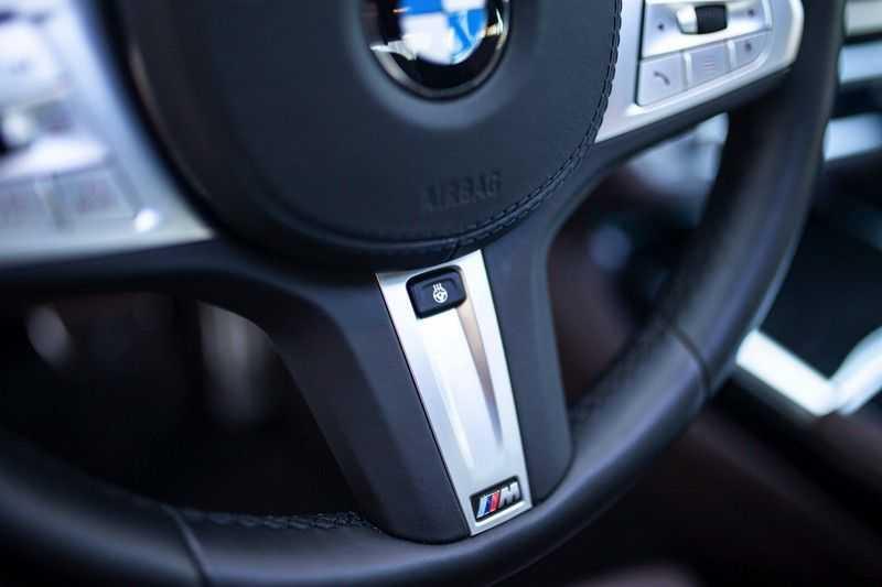 BMW 7 Serie 740d xDrive *Schuifdak / H&K / Memory / LED / ACC / Stoelventilatie* afbeelding 12