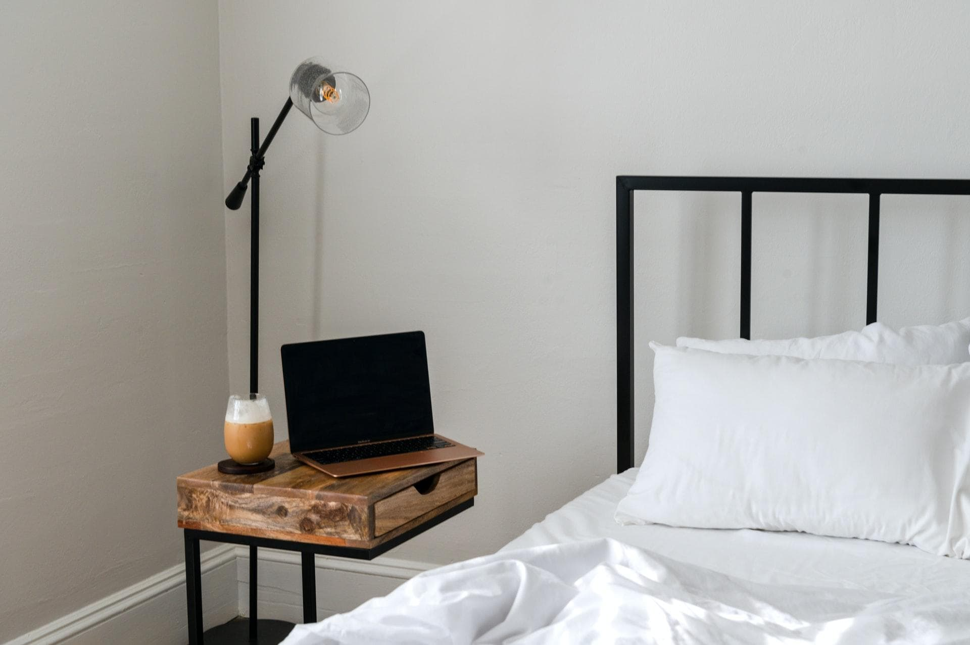 laptop beside the bed