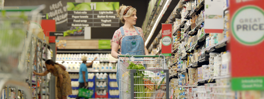 Photo of woman in supermarket with trolley