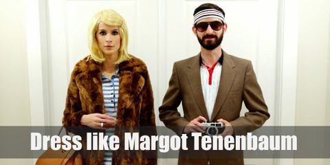 Margot Tenenbaum loves wearing her brown fur coat with a casual polo dress underneath. Margot adds an air of innocence to her look by putting a single clip on her blonde bangs.
