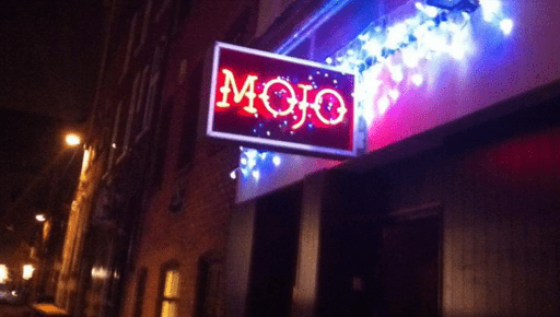 Mojo bar group neon sign on bar front wall
