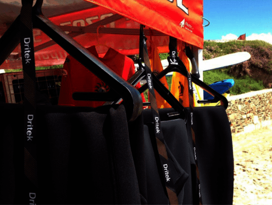 wetsuits on hangers