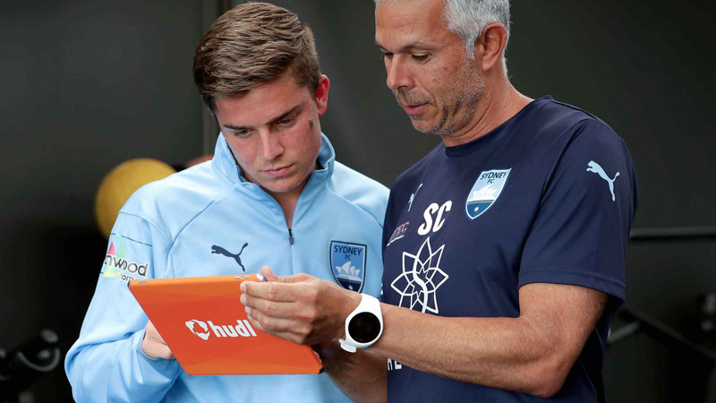Coach showing Sydney FC player analytics on a Hudl tablet
