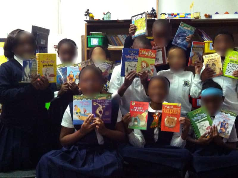 local school kids with donated books