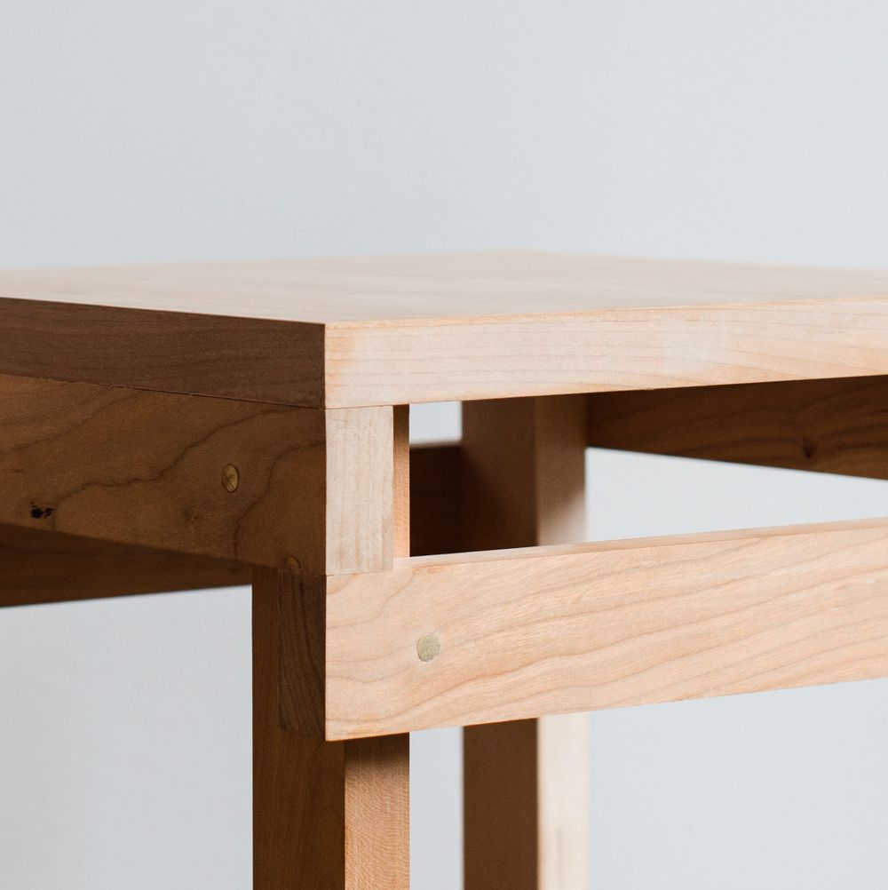 Detailed view of the bespoke solid cherry, felt and brass furniture designed by From Works at the National Justice Museum in Nottingham.