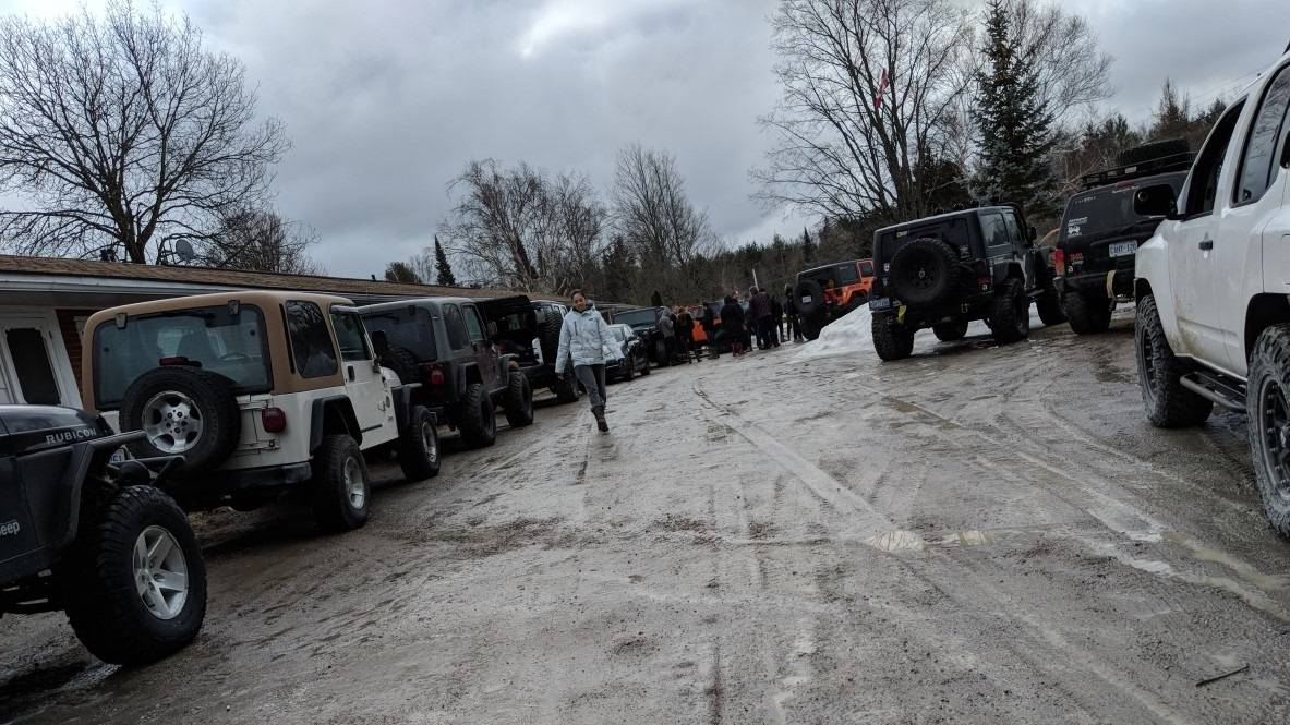 Arianne Gervais walking among Jeeps