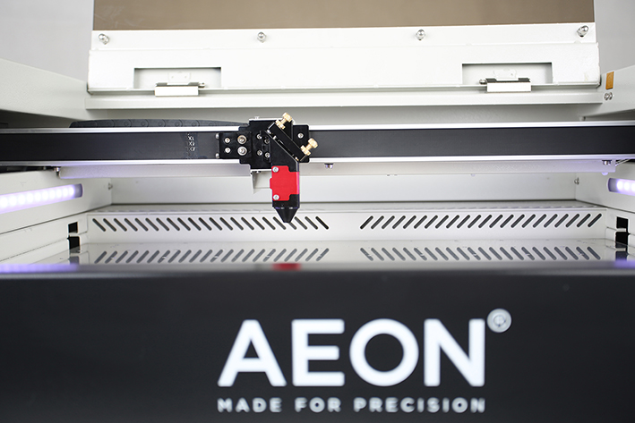 front view of bed and laser head on the Aeon Mira CO2 Desktop Laser Cutting Machine