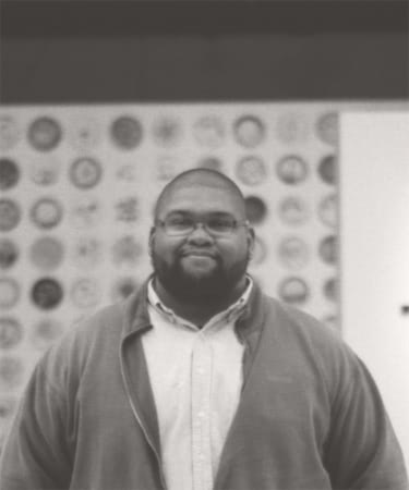 Headshot of Marcus Relacion inside the Center for Art Design and Visual Culture on the campus of the University of Maryland Baltimore County.