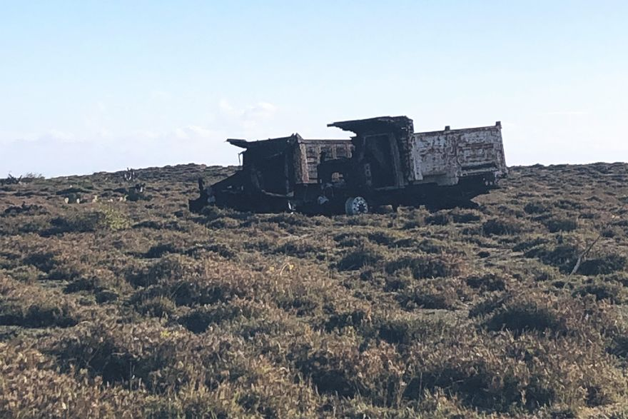 these burnt trucks on the side of san mateo del mar's entrance road are a sign of the Ikoot community's protest against proposed wind farm projects on their sacred land