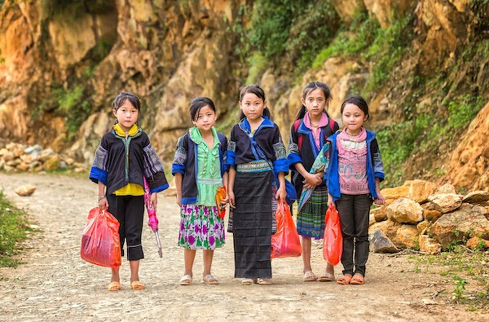 Students like these rural Vietnamese school children carrying books in plastic bags benefit from education nonprofit organizations.