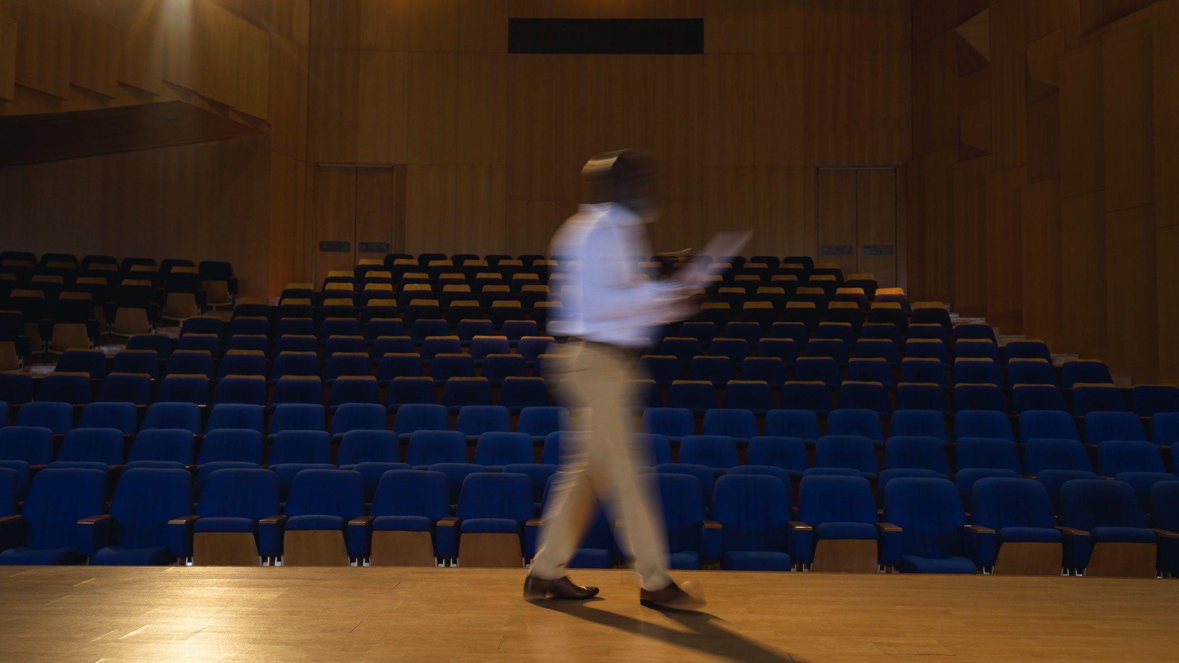Man walking on stage