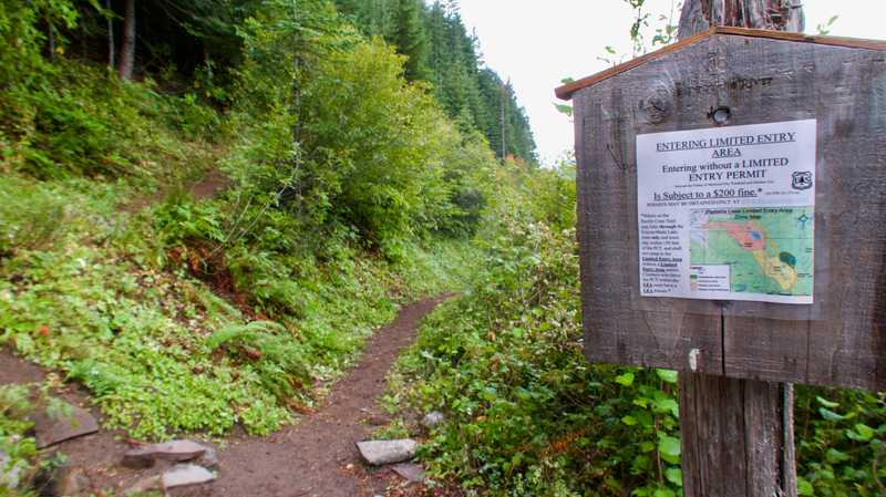 A sign warns of camping restrictions