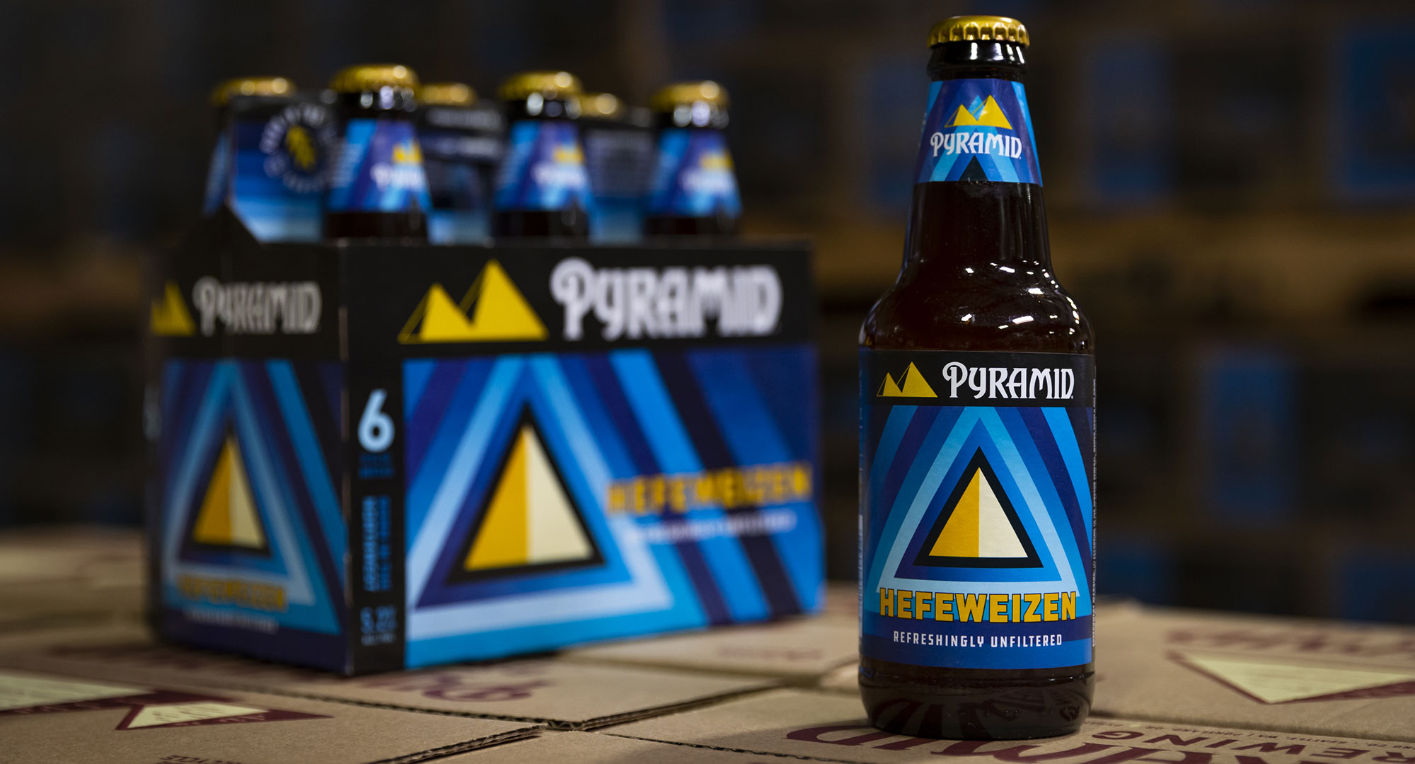 Hefeweizen 6-pack and bottle on Pyramid boxes